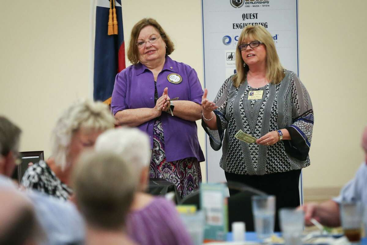 Rotarians Cecily Kelly, left, stands by as Rotarian Kris Nordstrom McBride, right, during the 85th anniversary of The Rotary Club of Conroe on Aug. 22, 2017, at the North Montgomery County Community Center in Willis.