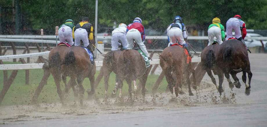 The field for the 139th running of The Alabama puts up a wall of mud going in to the clubhouse turn at the Saratoga Race Course Saturday Aug. 17, 2019  in Saratoga Springs, N.Y.  This was OrtizA•s third win in The Alabama.  Photo Special to the Times Union by Skip Dickstei