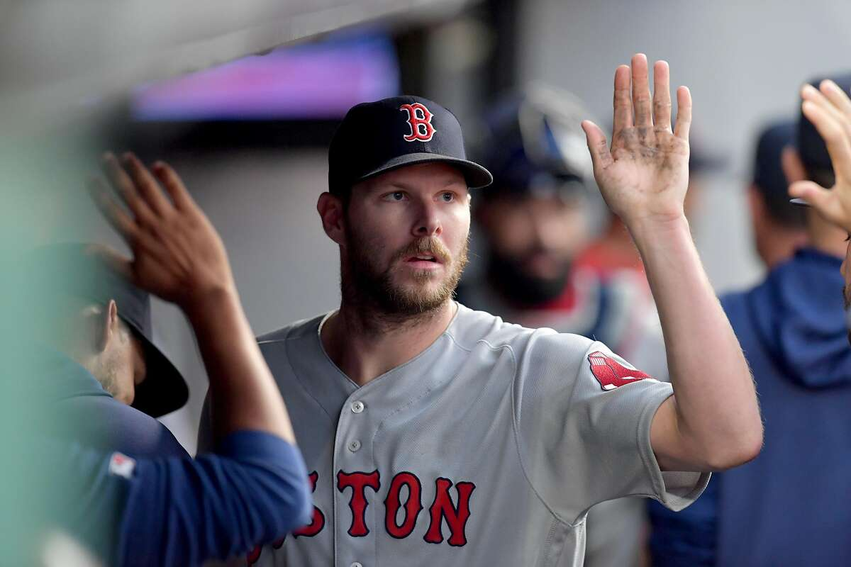 CORRECTED VERSION - CLEVELAND, OHIO - AUGUST 13: Starting pitcher Chris Sale #41 of the Boston Red Sox celebrates after throwing his 2,000th career strike out to end the third inning against the Cleveland Indians at Progressive Field on August 13, 2019 in Cleveland, Ohio. (Photo by Jason Miller/Getty Images)
