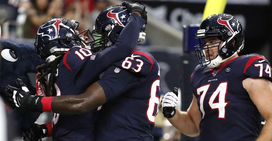 Houston Texans wide receiver DeAndre Hopkins (10), tackle Roderick Johnson (63) and tackle Max Scharping (74) celebrate Hopkins' 4-yard reception against the Detroit Lions during an NFL preseason football game at NRG Stadium on Saturday, Aug. 17, 2019, in Houston. Photo: Brett Coomer/Staff Photographer