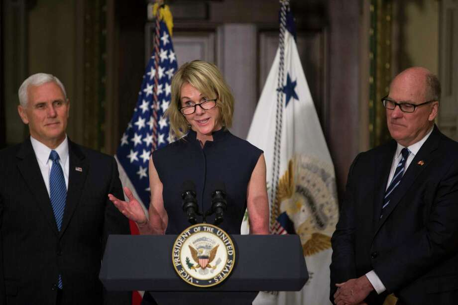 Kelly Knight-Craft speaks during her swearing-in ceremony to the office of U.S. Ambassador to Canada, in the Indian Treaty Room of the Eisenhower Executive Office Building in Washington, Sept. 26, 2017. Also pictured is Vice President Mike Pence, left, and Knight-Craft's husband, Joe Craft. (Tom Brenner/The New York Times) ORG XMIT: XNYT147 Photo: TOM BRENNER / NYTNS