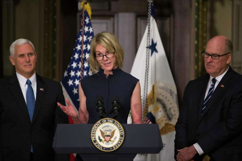 Kelly Knight-Craft speaks during her swearing-in ceremony to the office of U.S. Ambassador to Canada, in the Indian Treaty Room of the Eisenhower Executive Office Building in Washington, Sept. 26, 2017. Also pictured is Vice President Mike Pence, left, and Knight-Craft's husband, Joe Craft. (Tom Brenner/The New York Times) ORG XMIT: XNYT147