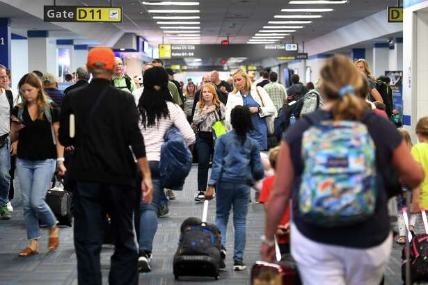 The hallways are jammed at the United wing of Dulles International Airport in Dulles, Virginia, on Aug. 7, 2019.