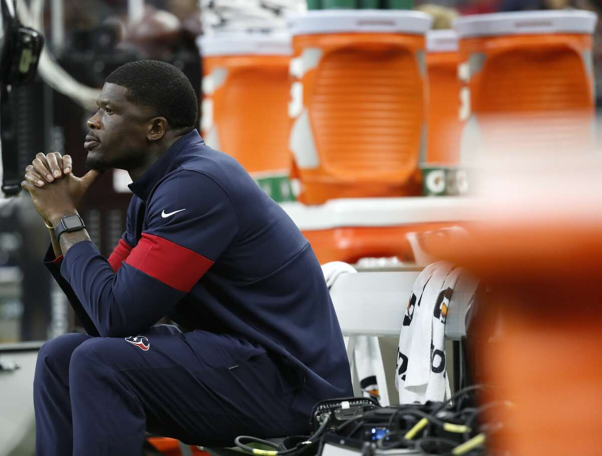 Former Houston Texans wide receiver Andre Johnson sits in the bench area before the start of an NFL football game at NRG Stadium, Saturday, August 17, 2019.