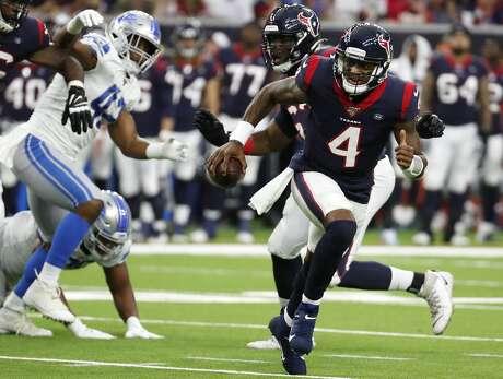 Houston Texans quarterback Deshaun Watson (4) scrambles out of the pocket during an NFL preseason football game against the Detroit Lions at NRG Stadium on Saturday, Aug. 17, 2019, in Houston.