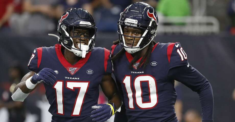 Houston Texans wide receiver DeAndre Hopkins (10) celebrates his touchdown with Vyncint Smith (17) during the first quarter of an NFL football game at NRG Stadium, Saturday, August 17, 2019. Photo: Karen Warren/Staff Photographer