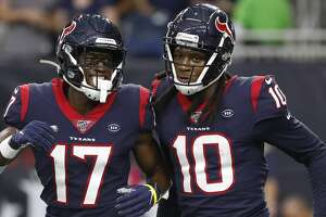 Houston Texans wide receiver DeAndre Hopkins (10) celebrates his touchdown with Vyncint Smith (17) during the first quarter of an NFL football game at NRG Stadium, Saturday, August 17, 2019.