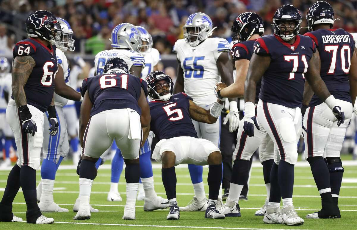 Houston Texans quarterback Joe Webb (5) is picked up off the turf by offensive guard Maurquice Shakir (61) and offensive tackle Max Scharping (74) during the second quarter of an NFL football game against the Detroit Lions at NRG Stadium, Saturday, August 17, 2019.