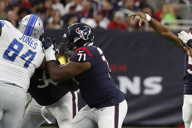 Houston Texans quarterback Joe Webb (5) lets a pass fly behind offensive tackle Tytus Howard (71) as he is pressured by Detroit Lions defensive end Jonathan Wynn (69) during an NFL preseason football game at NRG Stadium on Saturday, Aug. 17, 2019, in Houston.