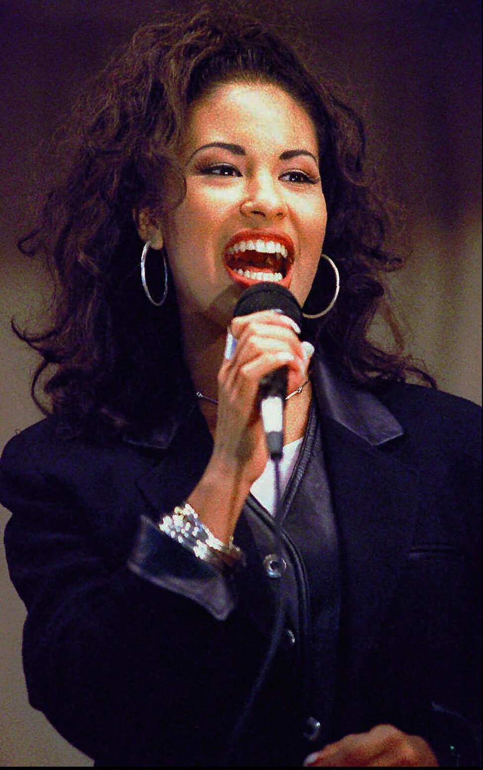 **FILE**Selena sings at the Cunningham Elementary School in Corpus Christi, Texas, in this Nov. 14, 1994 file photo. A decade after Selena was gunned down by the president of her fan club, her music legacy continues to thrive, winning over thousands of new fans, many of them young girls born after she died. (AP Photo/George Gongora-Corpus Christi Caller-Times)