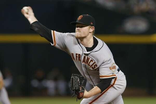 Giants roll D'backs as 22-year-old Logan Webb wins debut, Belt hits slam on six-RBI night