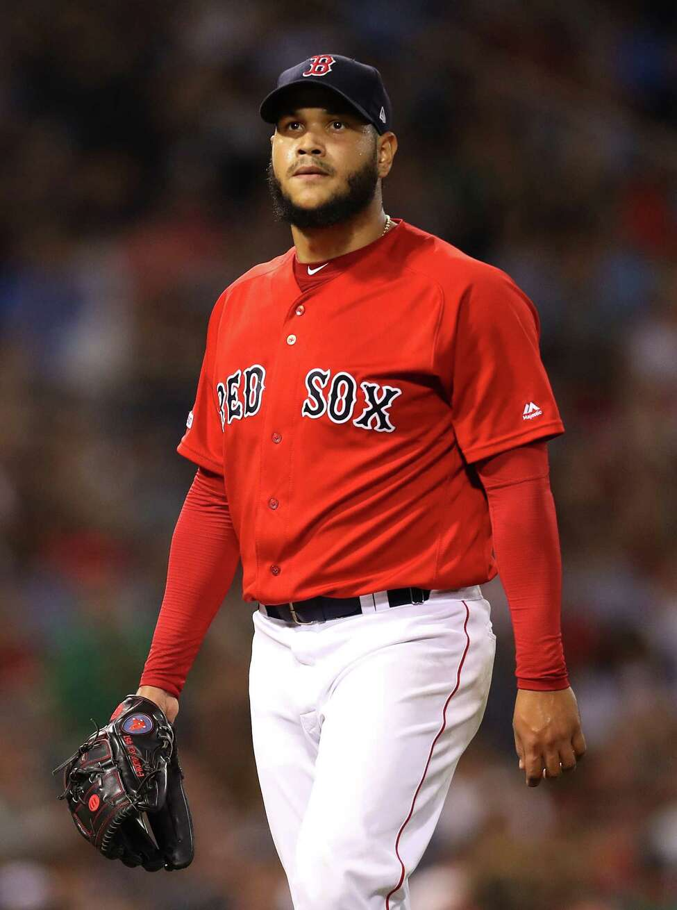 BOSTON, MASSACHUSETTS - AUGUST 17: Eduardo Rodriguez #57 of the Boston Red Sox exits the game after pitching during the seventh inning against the Baltimore Orioles at Fenway Park on August 17, 2019 in Boston, Massachusetts. (Photo by Maddie Meyer/Getty Images)