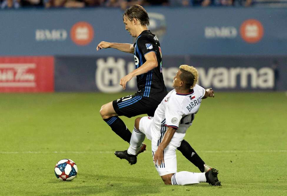 Montreal Impact's Lassi Lappalainen, left, challenges FC Dallas' Michael Barrios during first-half MLS soccer match action in Montreal, Saturday, Aug. 17, 2019. (Graham Hughes/The Canadian Press via AP)