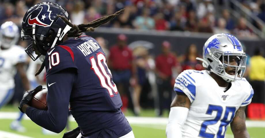 Houston Texans wide receiver DeAndre Hopkins (10) pulls down a 4-yard touchdown reception against Detroit Lions defensive back Quandre Diggs (28) during an NFL preseason football game at NRG Stadium on Saturday, Aug. 17, 2019, in Houston. Photo: Brett Coomer/Staff Photographer