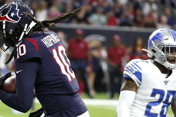 Houston Texans wide receiver DeAndre Hopkins (10) pulls down a 4-yard touchdown reception against Detroit Lions defensive back Quandre Diggs (28) during an NFL preseason football game at NRG Stadium on Saturday, Aug. 17, 2019, in Houston.