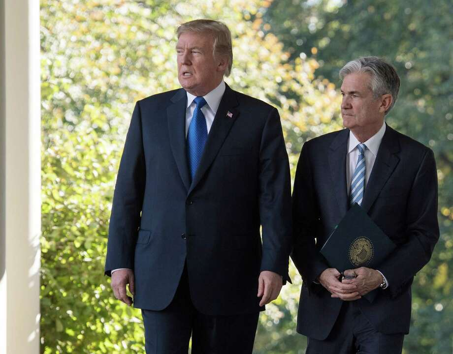 """(FILES) In this file photo taken on November 2, 2017, US President Donald Trump walks with Jerome Powell, Federal Reserve chairman, at the White House in Washington, DC. - US President Donald Trump on August 7, 2019, kept up pressure on the Federal Reserve, demanding more stimulus as Wall Street looked set to tumble on economic fears. He called the Fed, not China, is America's main economic obstacle. """"They must cut rates bigger and faster and stop their ridiculous quantitative tightening NOW,"""" he said on Twitter. (Photo by NICHOLAS KAMM / AFP)NICHOLAS KAMM/AFP/Getty Images Photo: NICHOLAS KAMM / AFP or licensors"""