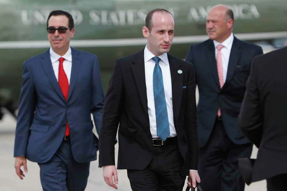 Treasury Secretary Steven Mnuchin, left, and White House Senior Adviser Stephen Miller prepare to board Air Force One, bound for an event in Indiana with President Donald Trump, at Andrews Air Force Base in Maryland, Sept. 27, 2017. The Trump administration on Wednesday proposed the most sweeping changes to the federal tax code in decades; Trump is scheduled to discuss the proposal at a Farm Bureau building in Indianapolis. (Doug Mills/The New York Times) ORG XMIT: XNYT88 Photo: TOM BRENNER / NYTNS