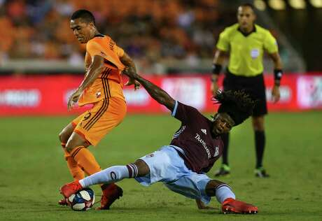 Dynamo forward Mauro Manotas, left, gets past Colorado's Lalas Abubakar during the first half at BBVA Stadium.