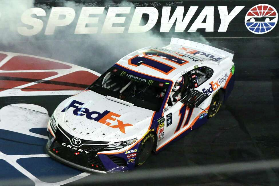 BRISTOL, TENNESSEE - AUGUST 17: Denny Hamlin, driver of the #11 FedEx Freight Toyota, celebrates with a burnout after winning the Monster Energy NASCAR Cup Series Bass Pro Shops NRA Night Race at Bristol Motor Speedway on August 17, 2019 in Bristol, Tennessee. (Photo by Sean Gardner/Getty Images)