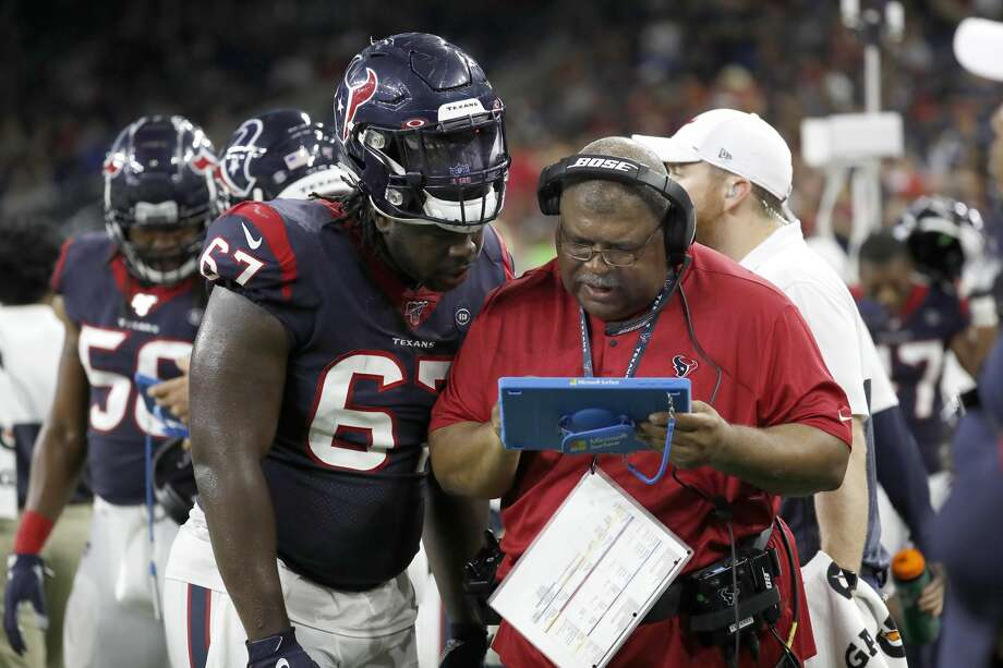 Houston Texans Assistant Head Coach Romeo Crennel works with defensive tackle Albert Huggins (67) during the third quarter of an NFL football game at NRG Stadium, Saturday, August 17, 2019. Photo: Karen Warren/Staff Photographer