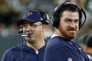 Houston Texans head coach Bill O'Brien, left, and offensive coordinator Tim Kelly work the sideline against the Green Bay Packers during a preseason NFL football game at Lambeau Field in Thursday, Aug. 8, 2019, in Green Bay, Wis.