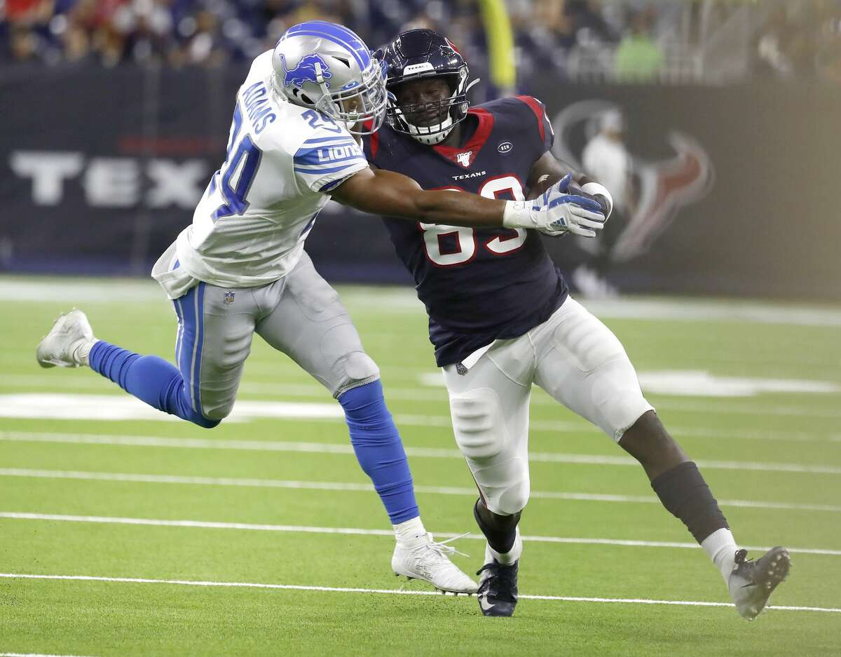 Houston Texans tight end Jordan Thomas (83) tries to gain yardage Detroit Lions defensive back Andrew Adams (24) during the third quarter of an NFL football game at NRG Stadium, Saturday, August 17, 2019.