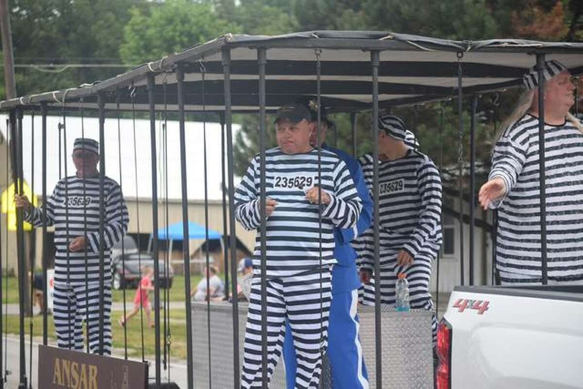 A float in the Bluffs Picnic Parade showed residents dressed as inmates throwing out candy.