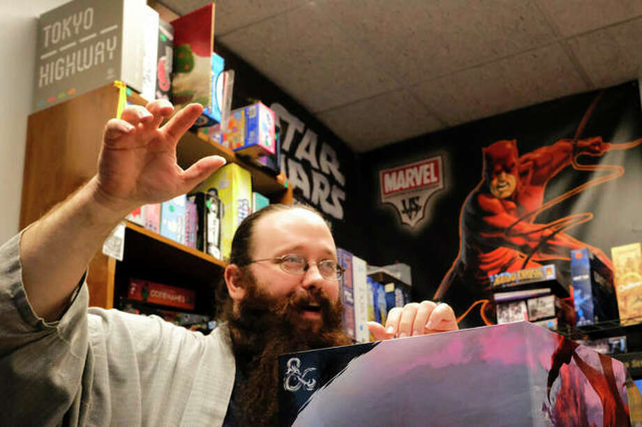 Dungeonmaster Keith Surman advances the plot of a game of Dungeons & Dragons at Castle Perilous in Carbondale. Photo: Isaac Smith | The Southern Illinoisan (AP)