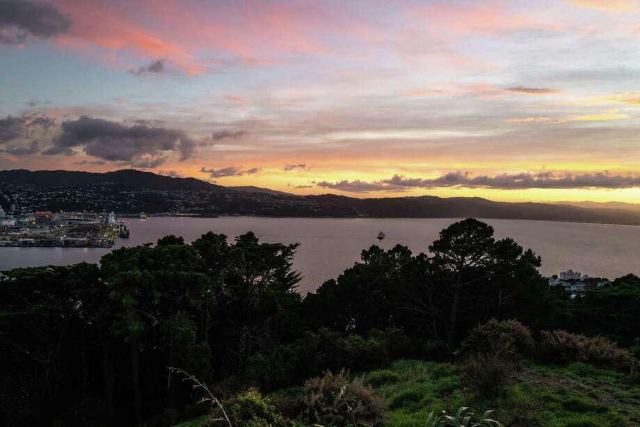 City views at sunrise, early morning at Mount Victoria Lookout in Wellington, New Zealand, in June. In 1973 things changed for New Zealand when Britain joined the European Economic Community, which meant abandoning its Commonwealth partner to favor European neighbors. Photo: Bloomberg Photo By Birgit Krippner / Bloomberg