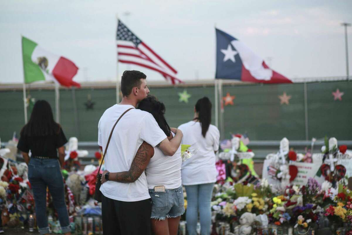 EL PASO, TX - AUGUST 15: People gather at a makeshift memorial honoring victims outside Walmart August 15, 2019 in El Paso, Texas. 22 people were killed in the Walmart during a mass shooting on August 3rd. A 21-year-old white male suspect remains in custody in El Paso which sits along the U.S.-Mexico border. (Photo by Sandy Huffaker/Getty Images)
