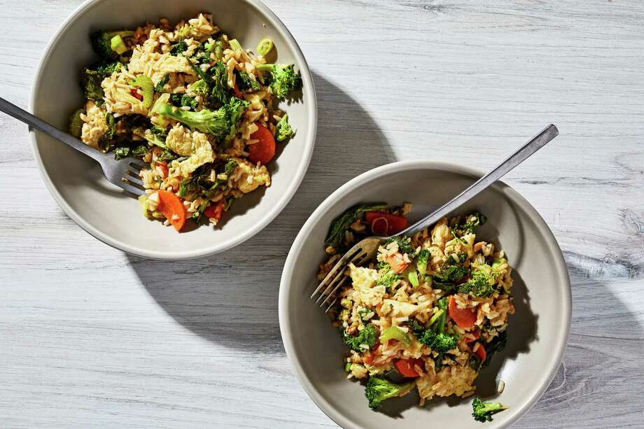 Fried rice with broccoli and mustard greens. Photo: Photo For The Washington Post By Stacy Zarin Goldberg / For The Washington Post