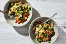 Fried rice with broccoli and mustard greens.