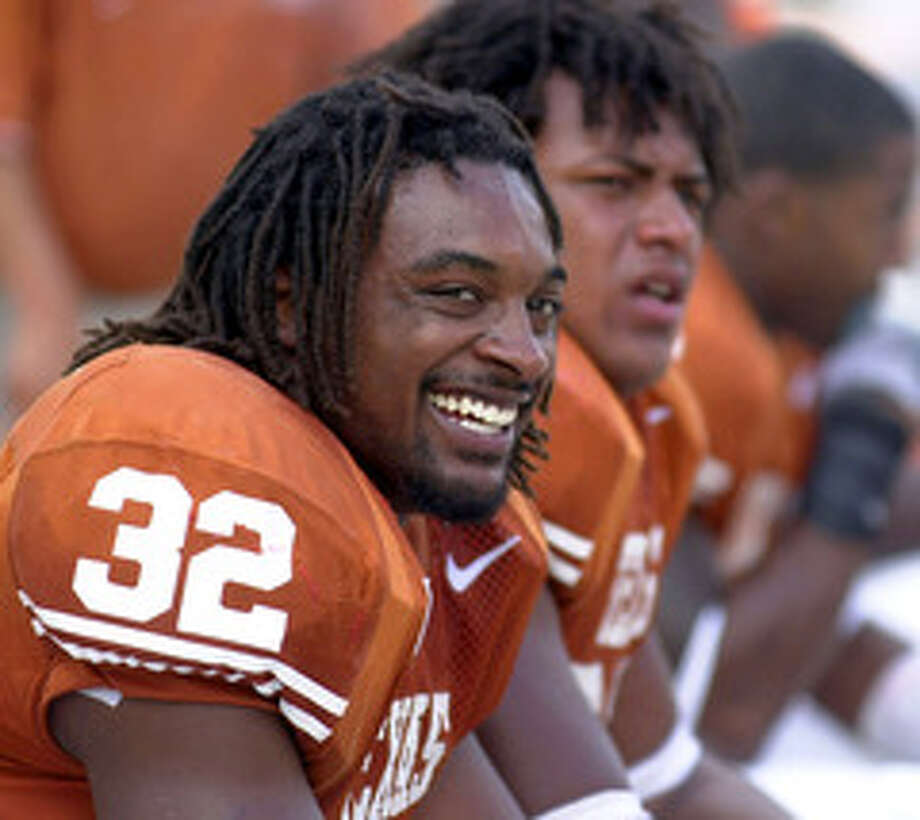 Texas' Cedric Benson (32) is all smiles as he sits on the bench after scoring a touchdown against Nebraksa Saturday Nov 1, 2003 at Texas Memorial Stadium in Austin,Tx. Texas went on to defeat Nebraska 31-7. PHOTO BY EDWARD A. ORNELAS/STAFF Photo: EDWARD A. ORNELAS, SAN ANTONIO EXPRESS-NEWS / SAN ANTONIO EXPRESS-NEWS