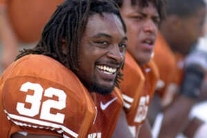 Texas' Cedric Benson (32) is all smiles as he sits on the bench after scoring a touchdown against Nebraksa Saturday Nov 1, 2003 at Texas Memorial Stadium in Austin,Tx. Texas went on to defeat Nebraska 31-7. PHOTO BY EDWARD A. ORNELAS/STAFF