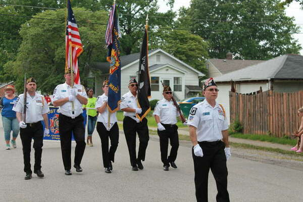 The Veterans of Foreign Wars Post 805 Honor Guard march Saturday during O'Fallon's 2nd Annual City Fest event.