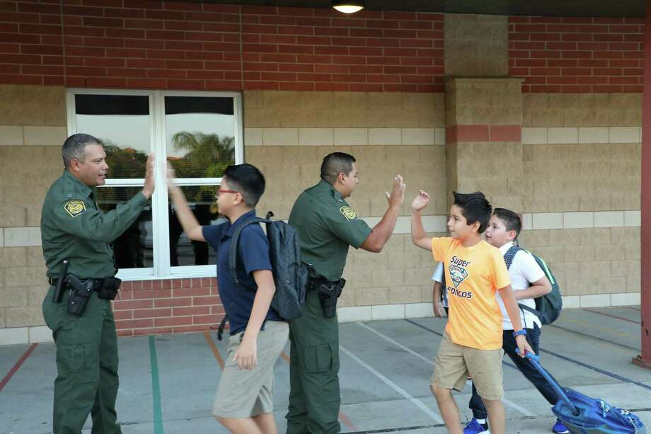 Laredo Sector Border Community Liaison Program agents welcomed UISD elementary students back to school with the Laredo Sector High-Five Program. Photo: Courtesy Of Laredo Sector Border Patrol
