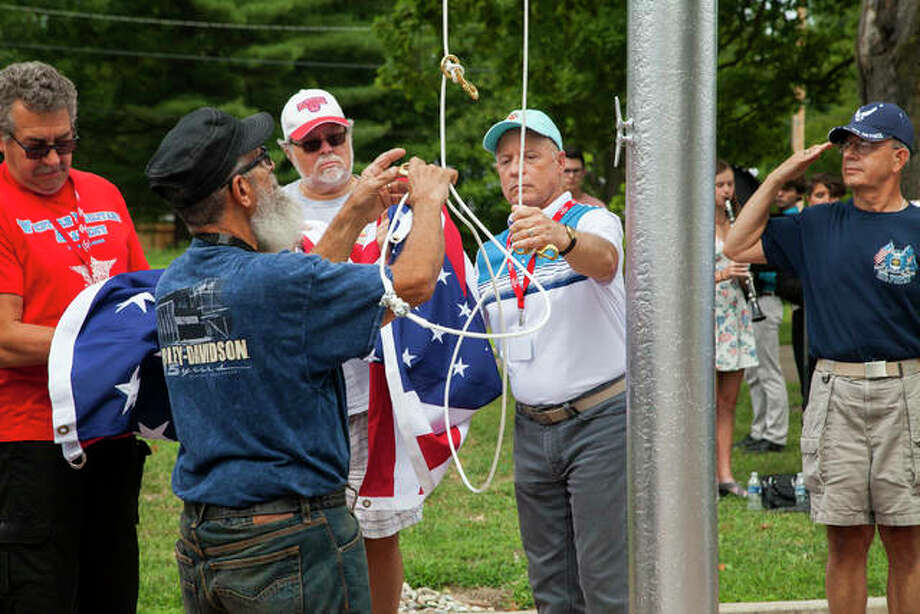 Western Military Academy alumni salute the flag as it is raised Saturday to mark the start of the 50th graduation anniversary for the class of 1970. Western Military Academy, located on the current site of Mississippi Valley School in Alton, started in 1879 and ran for 92 years before closing its doors in 1971. Photo: By Jeanie Stephens The Telegraph