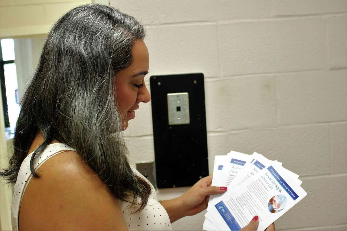 Megan DiMeglio, a project coordinator with the Norwalk Health Department, reviews hand outs that are related to a prevention campaign from the department.