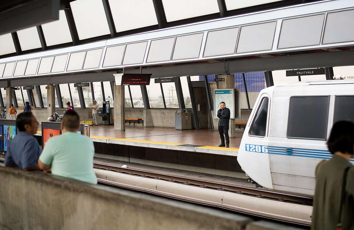 FILE - BART riders wait for a train at the Fruitvale station on Friday, Aug. 4, 2017, in Oakland, Calif. Officials confirmed Thursday that a new station is underway in Fremont.
