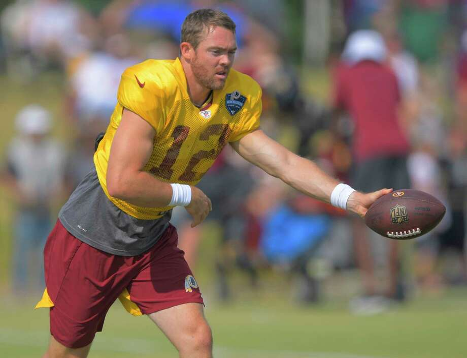 Redskins quarterback Colt McCoy (12), above during a drill last month, is still having issues with a leg injury. Photo: Washington Post Photo By John McDonnell / The Washington Post