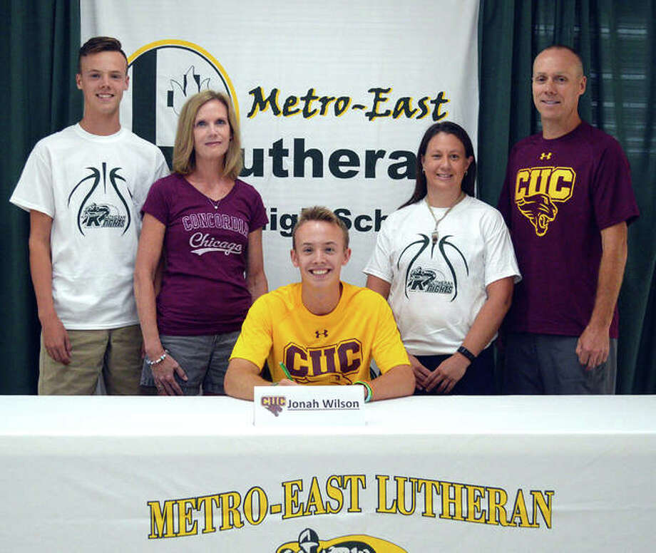 Jonah Wilson, a 2019 Metro-East Lutheran graduate, is joined by his family and MELHS coach Ruth Thompson as he commits to run cross country for Concordia University Chicago. Photo: Scott Marion/The Intelligencer