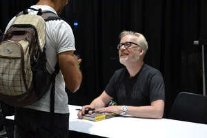 Adam Savage signs books for attendees at Silicon Valley Comic Con in San Jose on Saturday, August 17, 2019.