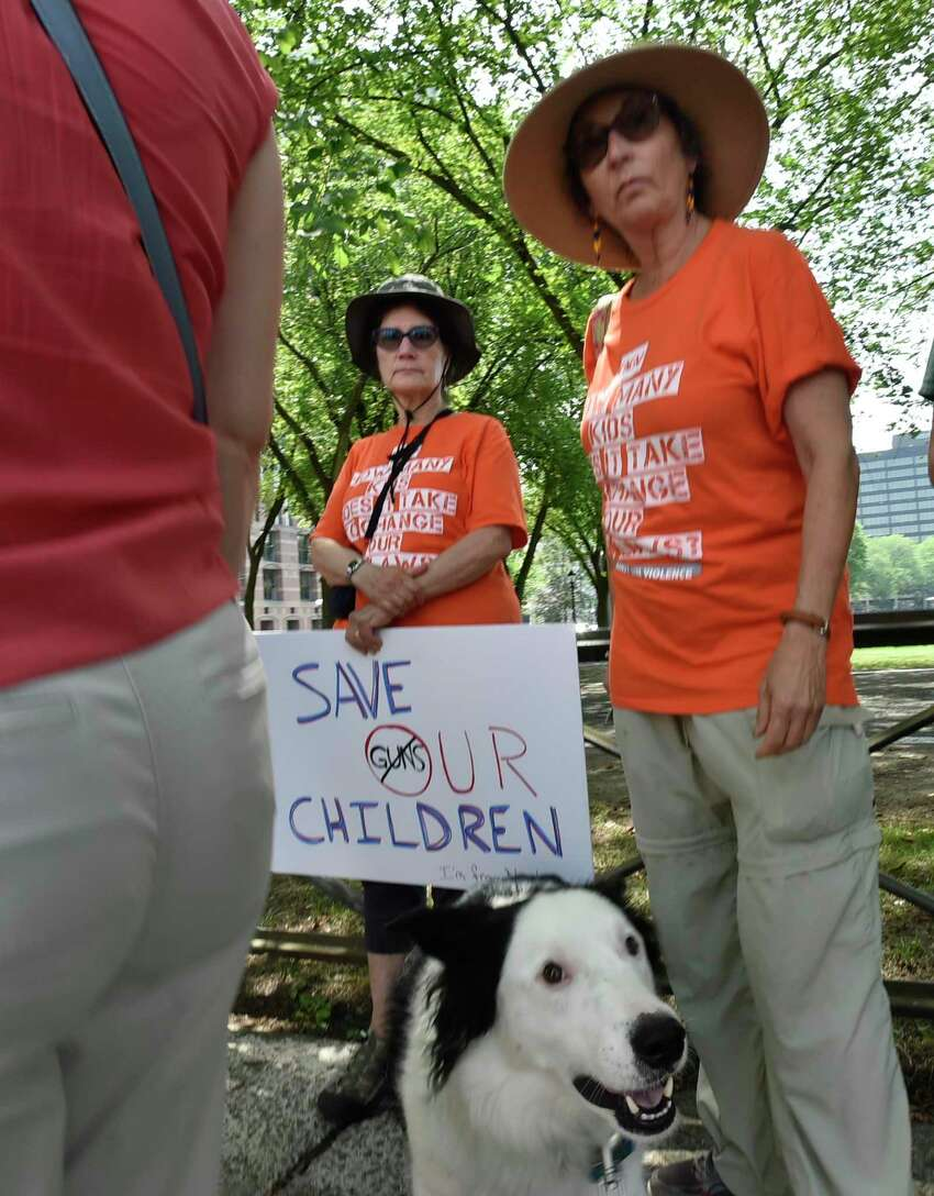 New Haven, Connecticut - Sunday, August 18, 2019: Volunteers with the Connecticut Chapters of Moms Demand Action for Gun Sense in America and Students Demand Action for Gun Sense in America activists, elected officials, and individuals affected by gun violence gather Sunday afternoon on the steps of the Courthouse on Elm Street and Church Street in New Haven Sunday to urge Senate Majority Leader Mitch McConnell to call the U.S. Senate back into session to take urgent action to pass universal background checks and a federal Red Flag Law.