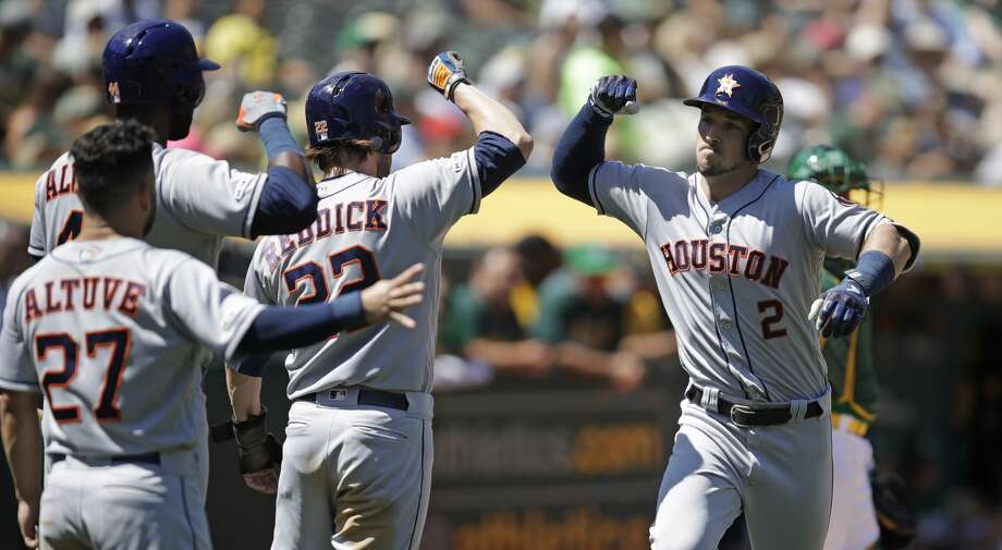 Houston Astros' Alex Bregman, right, is congratulated by Josh Reddick (22), Jose Altuve (27) and Yordan Alvarez after hitting a three run home run off Oakland Athletics' Brett Anderson in the fifth inning of a baseball game Sunday, Aug. 18, 2019, in Oakland, Calif. (AP Photo/Ben Margot) Photo: Ben Margot/Associated Press