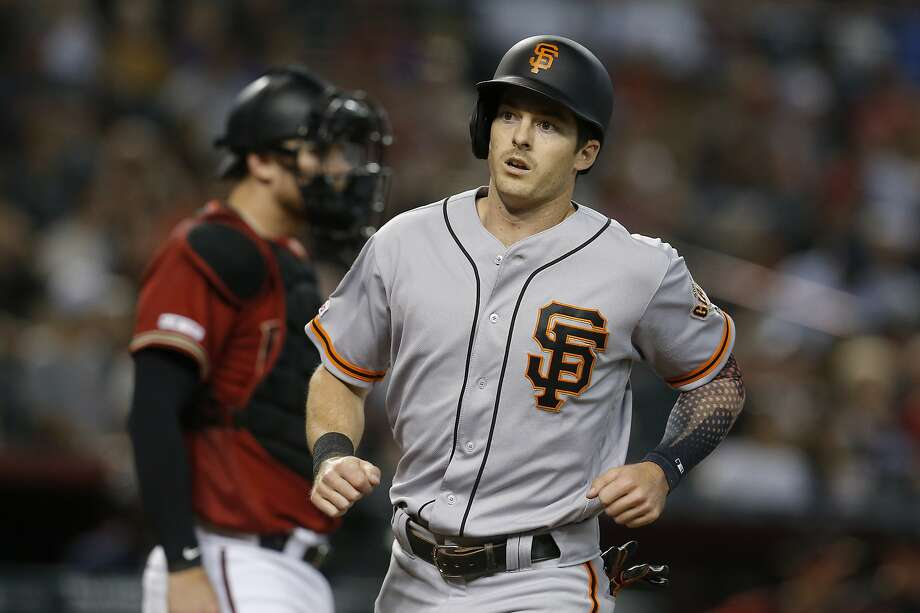 "FILE – San Francisco Giants' Mike Yastrzemski scores a run after a single by Scooter Gennett in the sixth inning of a baseball game against the Arizona Diamondbacks in Phoenix in this Sunday, Aug. 18, 2019 file photo. Yastrzemski has batted .282, hit 17 home runs and has 47 RBIs since being called up. His grandfather, Boston Red Sox legend and Hall of Famer Carl Yastrzemski said that he's ""very, very happy"" for Mike's success since getting a shot at the big leagues. Photo: Rick Scuteri / Associated Press"