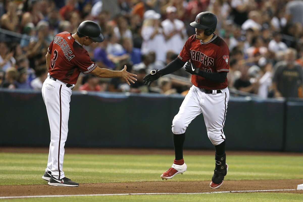 Arizona Diamondbacks' Wilmer Flores, right, celebrates with Tony Perezchica (3) after hitting a solo home run against the San Francisco Giants in the fifth inning of a baseball game, Sunday, Aug. 18, 2019, in Phoenix. (AP Photo/Rick Scuteri)