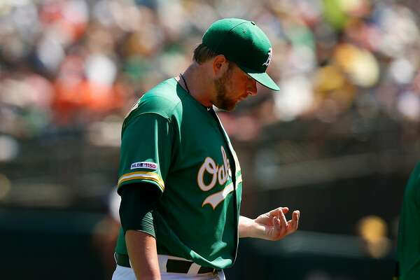 OAKLAND, CALIFORNIA - AUGUST 18: Starting pitcher Brett Anderson #30 of the Oakland Athletics looks at his hand as he leaves the game against the Houston Astros in the top of the sixth inning at Ring Central Coliseum on August 18, 2019 in Oakland, California. (Photo by Lachlan Cunningham/Getty Images)