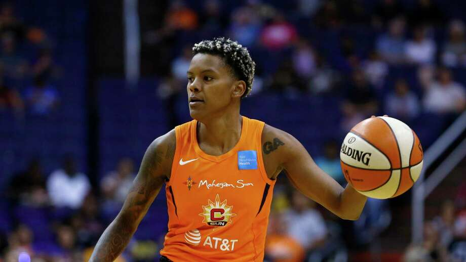 Connecticut Sun guard Courtney Williams dribbles the ball against the Phoenix Mercury on Wednesday in Phoenix. Williams scored 18 points in Sunday's 78-68 win over the Dallas Wings at Mohegan Sun Arena. Photo: Ross D. Franklin / Associated Press / Copyright 2019 The Associated Press. All rights reserved