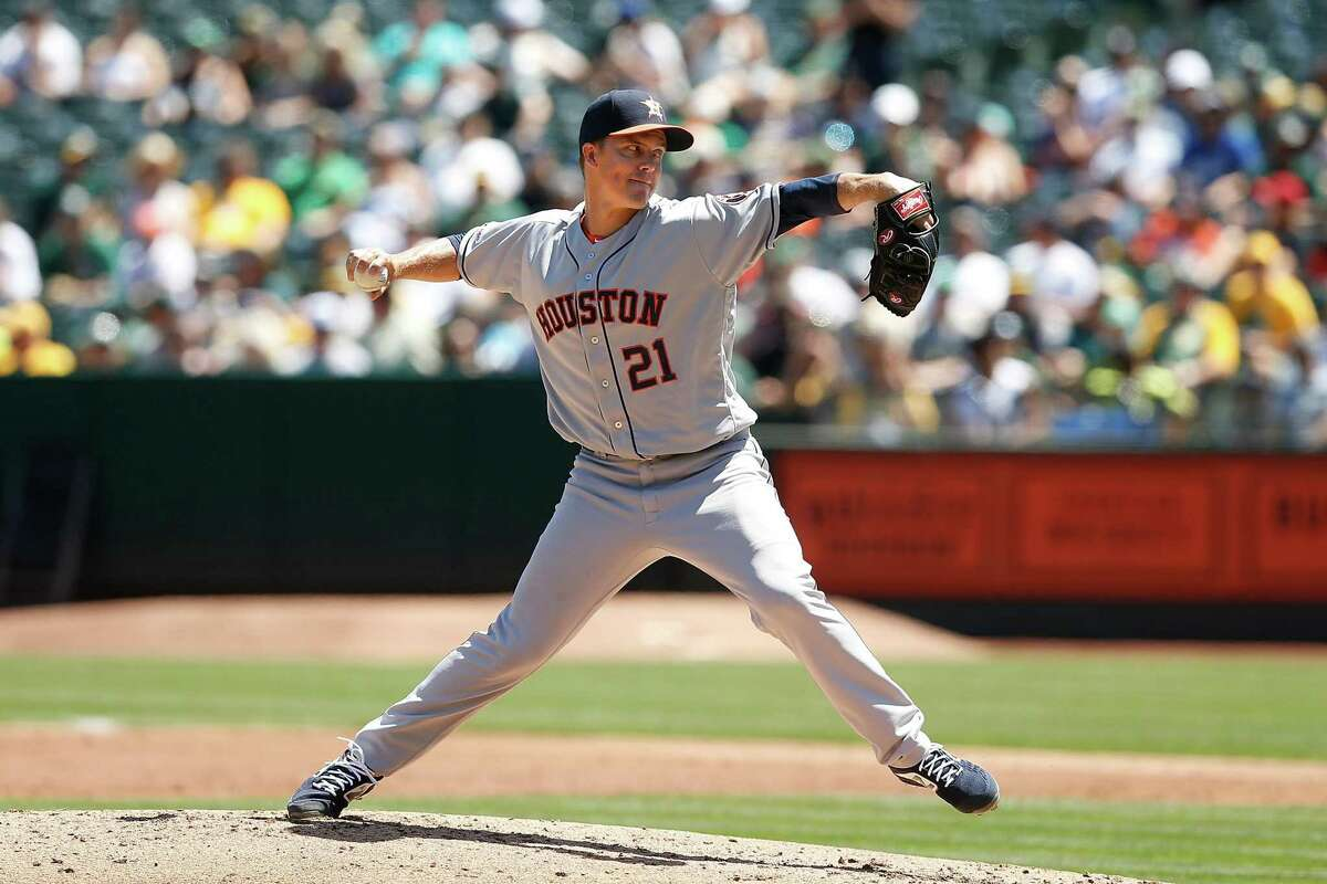 Zack Greinke (21) of the Houston Astros pitches in the top of the second inning against the Oakland Athletics at Ring Central Coliseum on August 18, 2019 in Oakland, California.