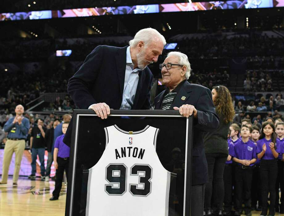 Peter Anton, 93, was honored for his 46 years of service with a game jersey by coach Gregg Popovich before the team's game with the New Orleans Pelicans in the AT&T Center on Feb. 2, 2019. Photo: Billy Calzada /Staff Photographer / San Antonio Express-News